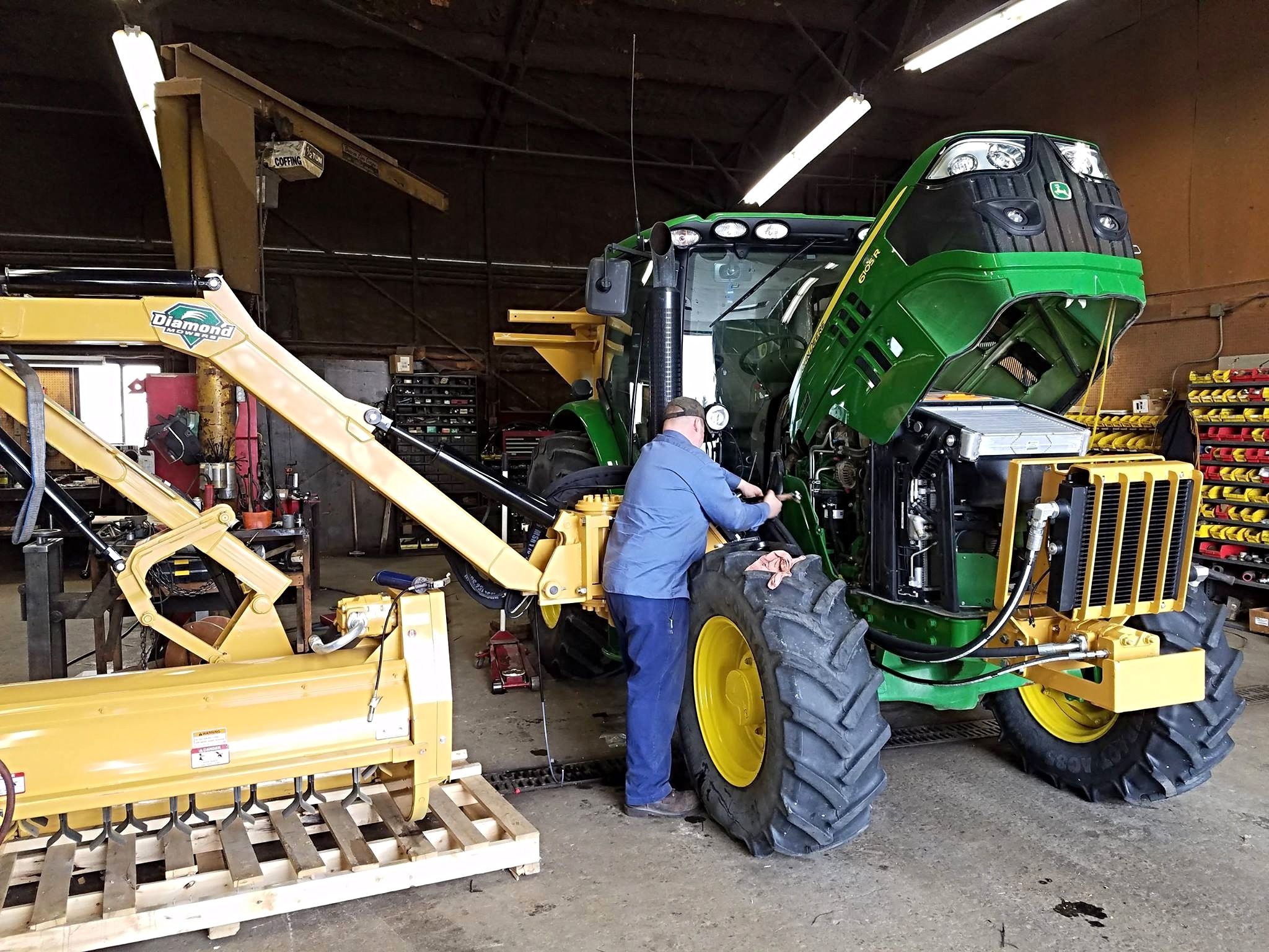 Man Maintenance A Tractor