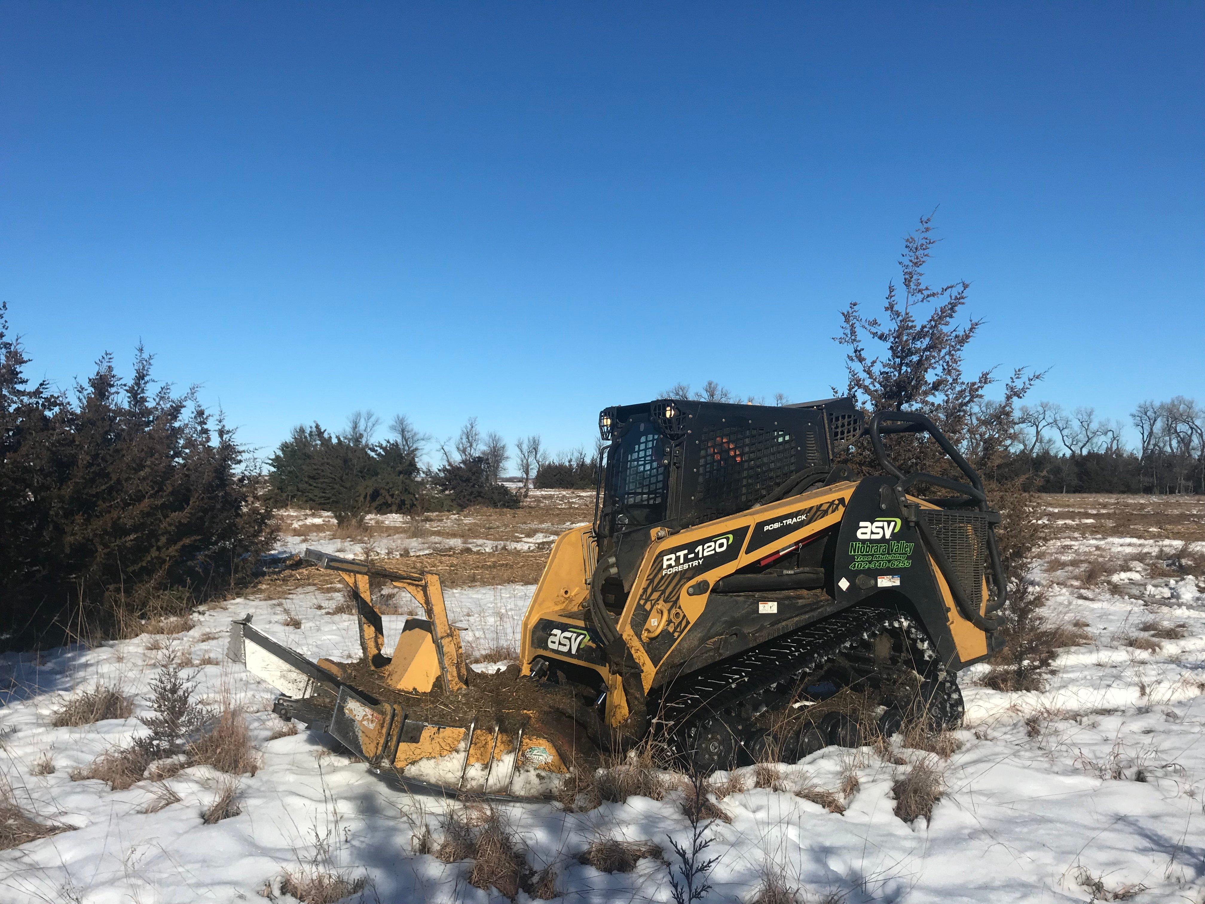 Skid-Steer Forestry Mulcher in snow
